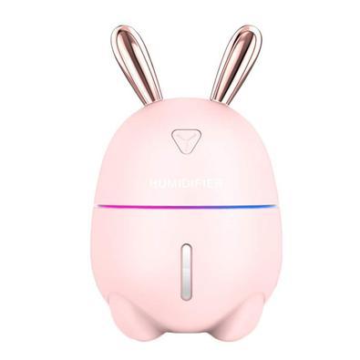 O mini umidificador de ar possui um design elegante e atrativo para todas as idades de coelho na cor rosa, acompanhando um par de orelhas. Modelo de u